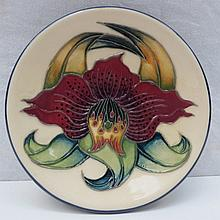 A Moorcroft pottery dish with Anna Lily design.