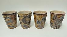 Four German art nouveau pottery beakers.