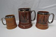 Three graduated silvered commemorative mugs from