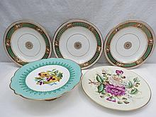 A flower decorated dessert plate, three other hand