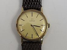 A lady's 9ct Omega strap watch, gilded dial with