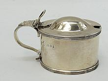 An HM silver lidded mustard pot, London made, with