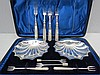 A pair of HM silver shell like dishes with