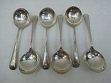 A set of six HM silver London made soup spoons,