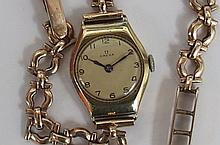 A Ladies 9ct gold cased Omega watch on 9ct stamped