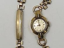 An 18ct ladies Omega dress watch c1950 on gold