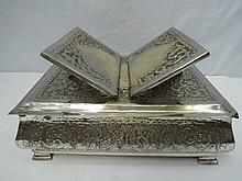 A silver plated cushion shaped table top bible
