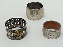 Three napkin rings in HM silver and silver plate,