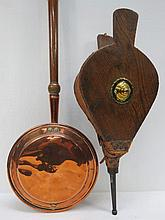 A copper warming pan with turned fruitwood handle. Also a pair of 19thC elm bellows AF. Two items.