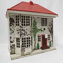 A vintage Triang dolls house, plywood and tin with a plastic roof; 44cm x 49cm x 29cm.
