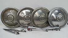 Automobilia. Four Morris Minor hubcaps c1950's also a bonnet handle and three boot hinges.