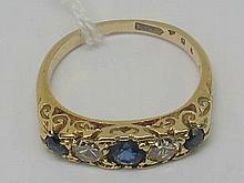 A carved head 18ct stamped five stone sapphire and diamond ring.