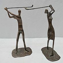 A pair of bronze figures of golfers, 25cm high.