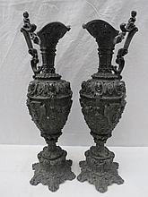 A pair of Renaissance style metal ewers in highly