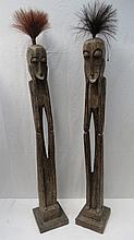 A pair of ethnic tribal figures, carved from