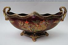 A Carlton ware rouge royale large twin handled