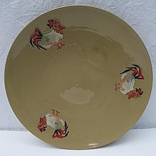 A Moorcorft plate with Cockerel design on a buff