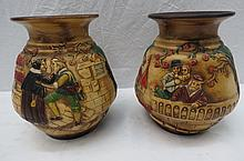 A pair of Bretby pottery vases modelled with