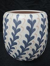 A Poole Pottery vase decorated in the YFC pattern,
