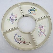 A set of four Poole Pottery hors d'oeuvres dishes,
