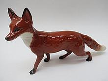 A large Beswick figure of a prowling fox, 13cm