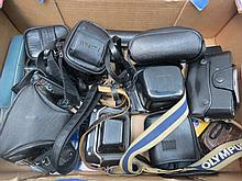 A large collection of cameras and equipment -