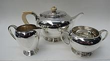 An HM silver three piece tea service in plain