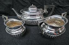 An HM silver three piece tea service in Queen Anne
