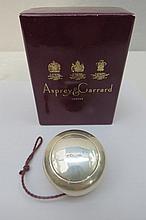 An HM silver yo-yo retailed by Asprey & Garrard of