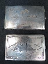 A white metal cigarette case engraved with