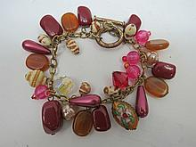 A yellow metal bracelet with crystals, beads and