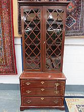 A fine bookcase on chest, the twin glazed lattice