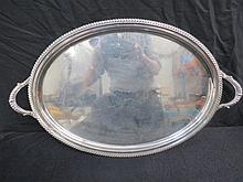 A large oval twin handled tray with gadrooned