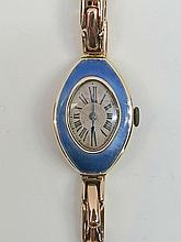 A ladies cocktail watch, oval dial, light blue