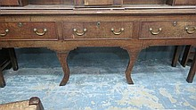 A late George III oak dresser base, the