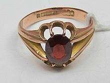 A gents oval claw set garnet dress ring 3.5g set