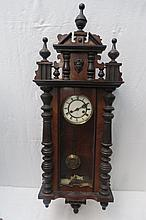 A Victorian mahogany Vienna clock, the enamelled