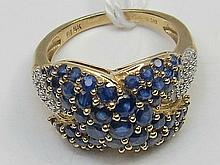 A sapphire and diamond cluster ring, sapphires in