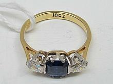 A natural sapphire and diamond three stone ring,