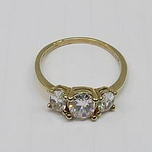 A three stone cubic zirconia ring set in a 9ct
