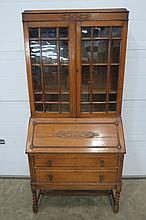 A 20thC oak bureau bookcase, with a blind fret