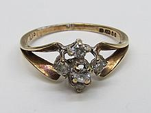 A 9ct yellow gold diamond dress ring with four