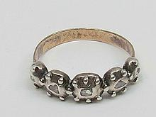 An antique diamond five stone ring each of the