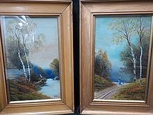 A pair of gilt framed oil paintings signed by W.