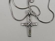 A crucifix in 18ct white gold by Mappin & Webb set