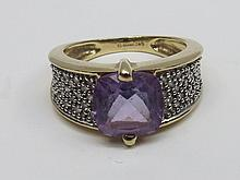 A mixed cut cushion shaped amethyst ring with wide