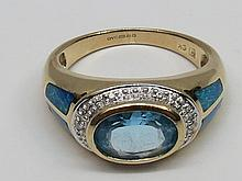 Untested transverse blue topaz ring, central stone