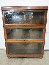 An oak three section Globe Wernicke bookcase and