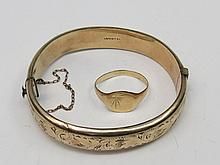 A hollow gold plated engraved bangle and cushion