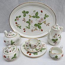 A miniature bone china tea set by Wedgwood having